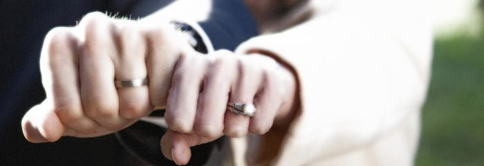 married couple hands with wedding rings